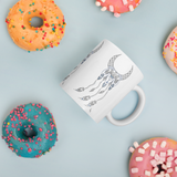 Sacred Geometry Feather Mug with donuts for scale