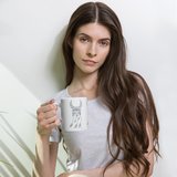 Person holding Sacred Geometry Feather Mug
