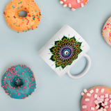 Flower Mandala Coffee Mug with donuts for scale