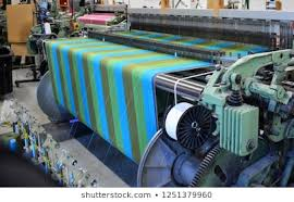 Process of weaving in a powerloom machine