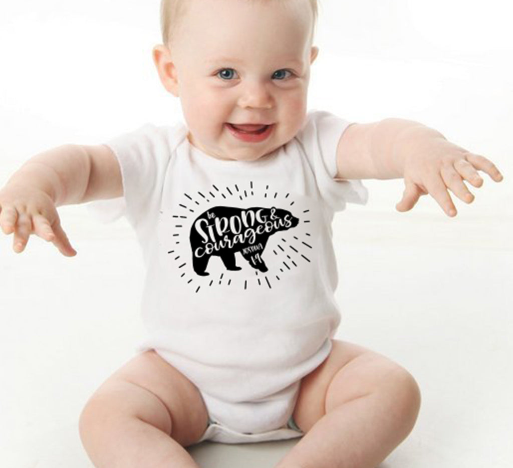 Strong and courageous Baby bodysuit