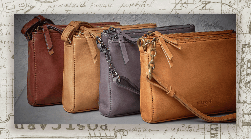 The Jules mini crossbody, available in rich brown, tan and gray genuine leather.
