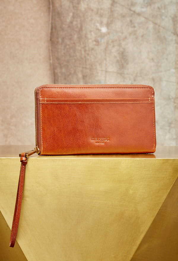 Gabby Wristlet Zip Around Wallet in Cognac
