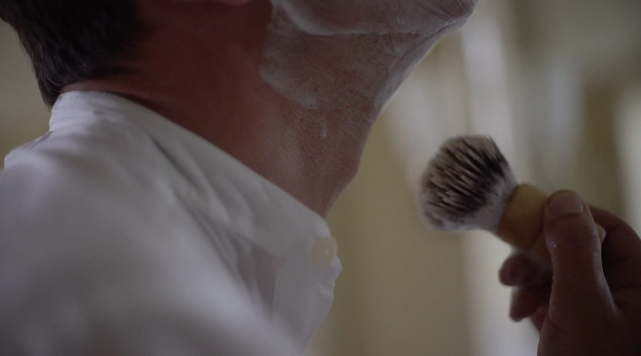 The perfect shave demonstrated by Enzo Cilenti. Moisten the bristles of the brush and gently work the shave soap into a lather.