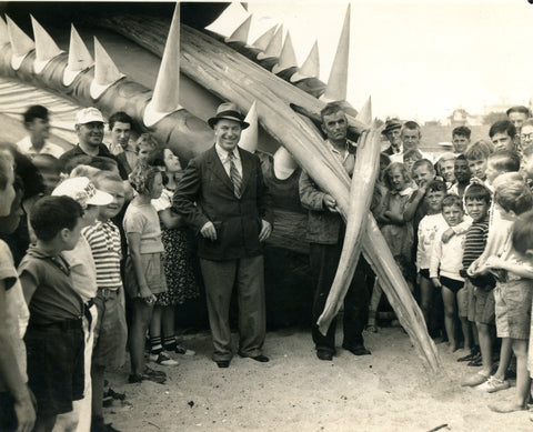 Tony Sarg and spectators pose in front of the sea monster's mouth. | MimsHouseBooks.com