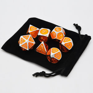 Orange and silver metal dice