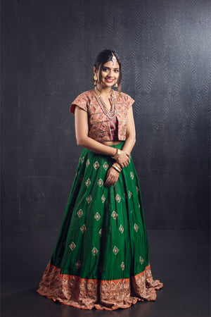 Orange green silver zari jacket lehenga