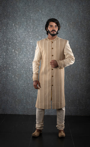 Cream embroidered sherwani with gold embellishments