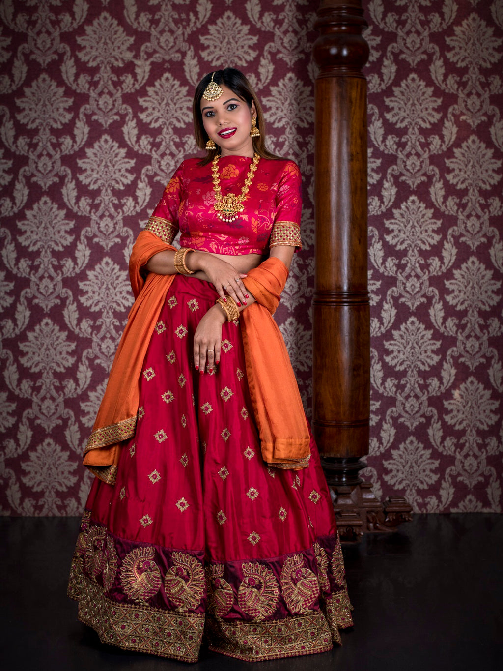 Shades of red handcrafted gold zari lehenga
