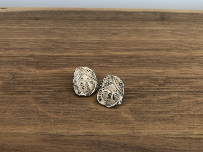 Womyn Earrings in Silver