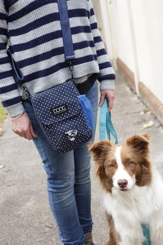 The walkie bag features a built in pocket to hold DOOG Tidy Bags which can be pulled out like tissues for easy access  Large enough to hold all your valuables but small enough to be comfy on a long walk