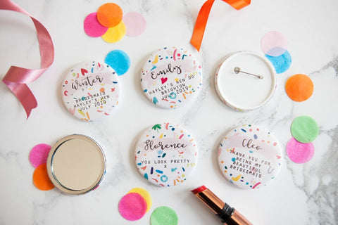 https://www.weddinginateacup.co.uk/shop/products/personalised-colourful-confetti-print-big-badge-or-mirror