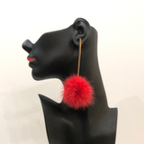 Pink fur ball drop earring on gold chrome bar