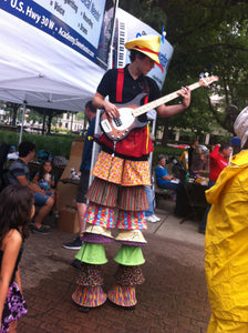 bass playing stilt walker