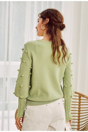 Elegant fur pompon sweater
