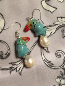 Ice Parrot Pearl earring - Ice Blue Ceramic Parrot with large Baroque Pearl.