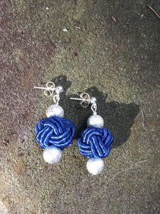 Blue Knot earrings - silk knot bead with hammered silver bead finials.