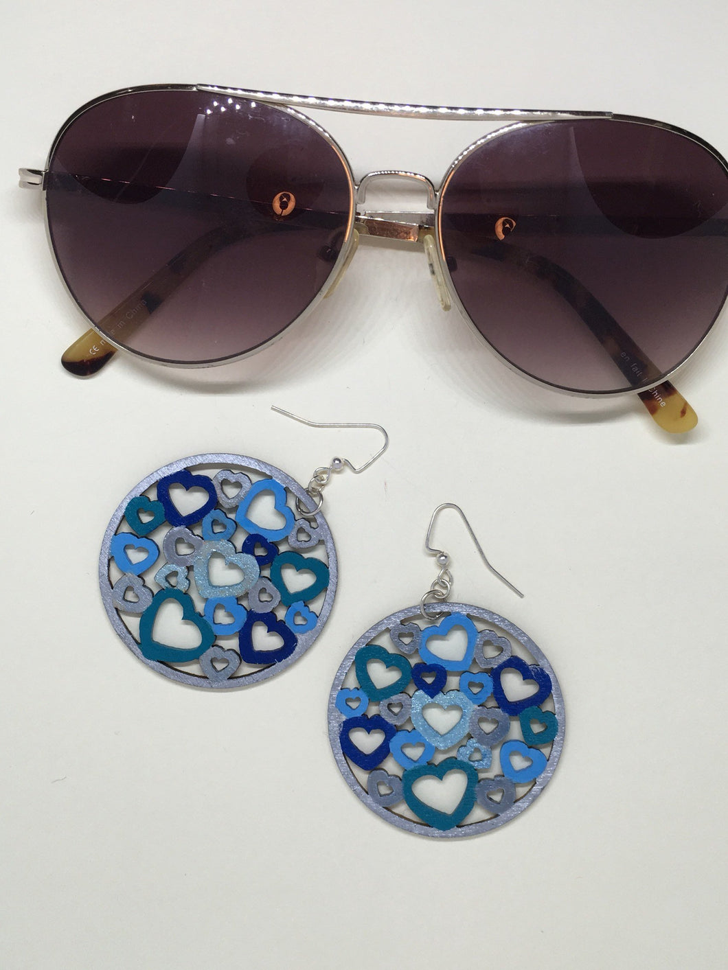 Blue Hearts - enamel hand painted wood on silver