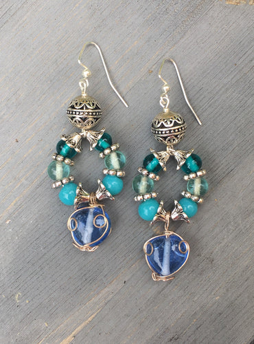 Blue wired Heart glass with turquoise blue howlite beads on silver loop earring