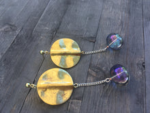Load image into Gallery viewer, Gold brass disc with lightly blue tinted clear glass globe on fine silver chain earrings