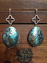 Load image into Gallery viewer, Blue Abalone Haliotis shell nugget on silver rhinestone embellished cross on silver stud earring