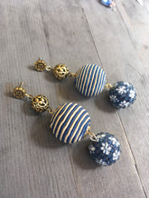 Load image into Gallery viewer, Blue glass ornate flower bead on blue beige silk bead with brass ornate bead earring