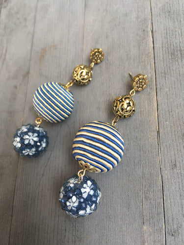 Blue glass ornate flower bead on blue beige silk bead with brass ornate bead earring