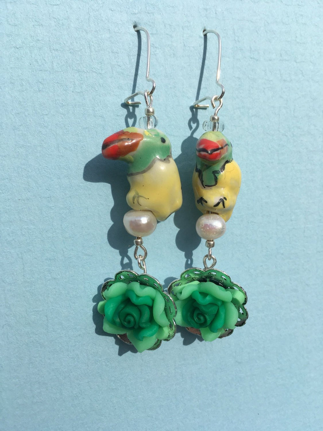 Yellow Ceramic Parrot on Pearl with Green Flower