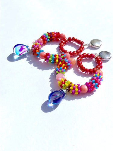 Multicolored pink Rainbow beaded creole with dyed glass pendant on silver stud earring