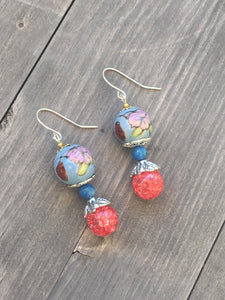 Handpainted ceramic sky blue bead with marbled pink quartzite bead with dark blue Howlite bead as spacer