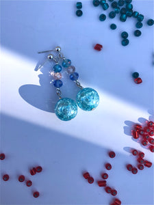 Aqua blue crackled glass sphere and blue, white, green rose cut glass beads on silver stud earring
