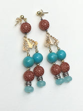 Load image into Gallery viewer, Engraved wood with turquoise bead chandelier earrings