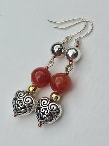 Silver ornate heart on amber stone with gold and silver bead dangle Earring