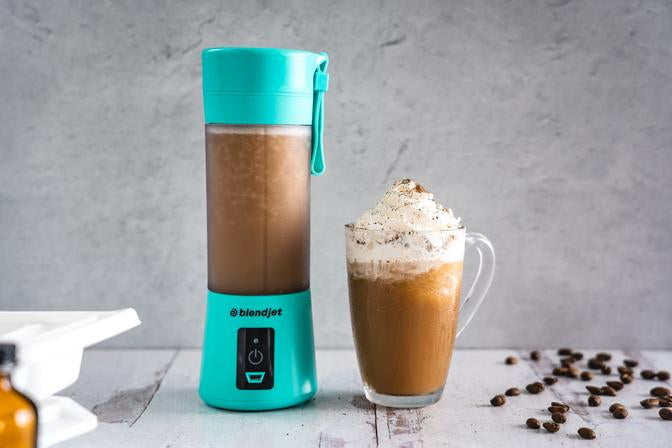 Vanilla Frozen coffee drink in a turquoise BlendJet