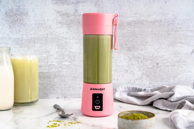 Iced Matcha Latte frozen coffee drink in a pink BlendJet