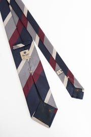 rear of a striped tie with the fumagalli tag- retro di una cravatta a righe con il cartellino fumagalli