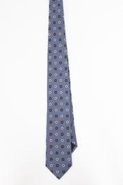 front view of a silk light blue tie with red and white details-visione frontale di una cravatta in seta con dettagli rossi e bianchi