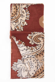 paisley detail of the scarf with light brown and white texture