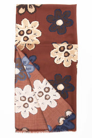 all the design of flowers on the scarf with brown and white flower