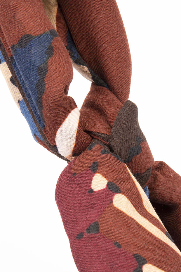 brown, red, blue detail on a knot on a scarf