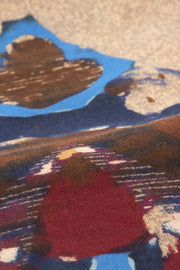 red light blue brown and light brown detail on a wool scarf
