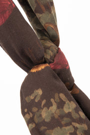 brown scarf with green leaves and golf theme