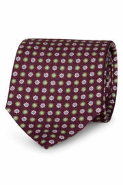 purple background and green & white daisies printed on a handmade silk tie