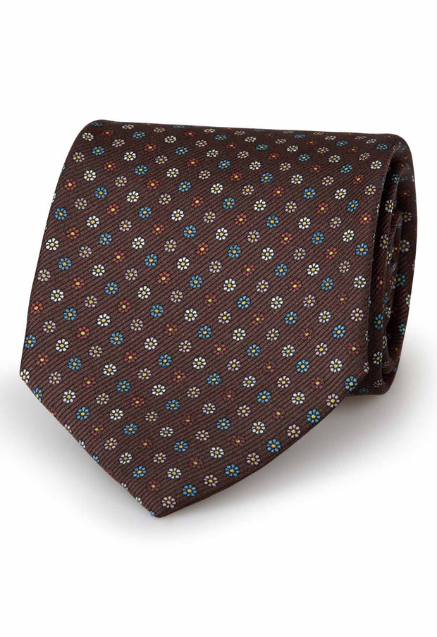 brown silk hand made tie with little daisy patterned of different colours