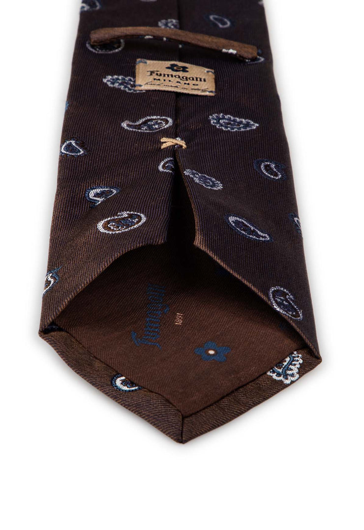 on the back of the tie there is a fumagalli label and the lining is brown with fumagalli logo
