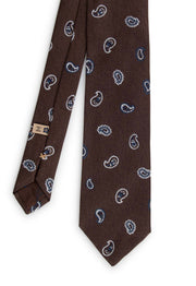 vision of the front of the tie with paisley details that stand out of the brown background