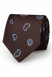 this brown tie has a paisley pattern with two different type of paisley