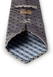 fumagalli label on the back of the tie with diamonds and flower