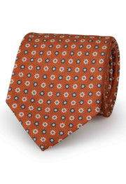 hand made orange tie with different colour floral pattern