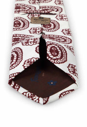 hand made printed tie with burgundy fantasy pattern and fumagalli label